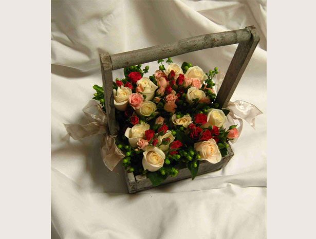 flowers in wooden basket