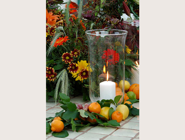 candle and fruit centerpiece
